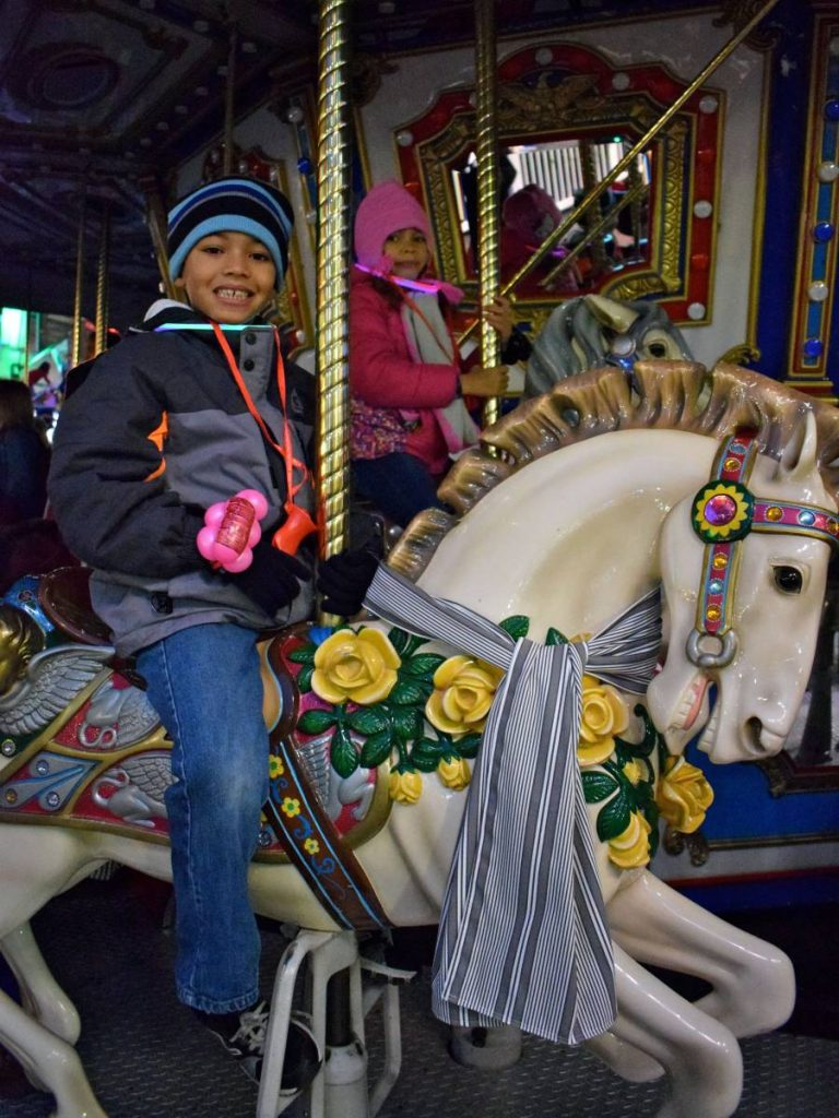 boy-on-carousel